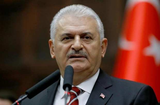 Turkish PM says constitution plan to go to parliament after Russia trip